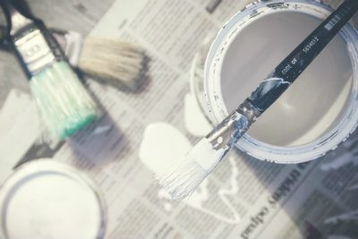 White paint and brushes