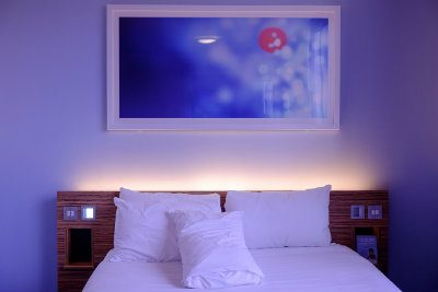 White bedroom with blue light